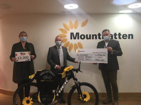 Cllr Ward presenting £8000 to Mountbatten Hospice